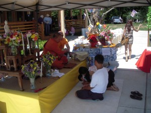 Ajahn Ritthi Thirajitto blesses Thai people during the monastery's annual picnic, a week after receiving an occupancy permit