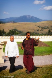 Tulku Sang-ngag shows the garden to Tashi Namgyal, a North American-based elected representative to the Tibetan Government in exile, in India