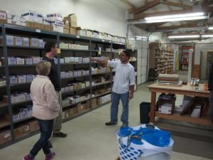 Anand Kulkarni showing customers our warehouse in Onalaska.