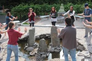 Teens explore Qi Gong in the garden at Cloud Mountain