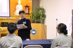 Tzu Chi Commissioner LilyTai explains the precepts of Tzu Chi to new volunteers