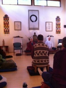 The retreatants settle into meditation.
