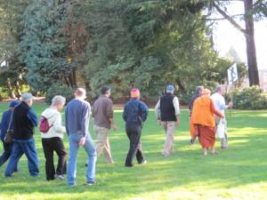 Volunteers start their three-mile walk