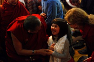After the Milarepa empowerment Garchen Rinpoche stopped to greet and bless student Yumemi Malm, who attended the program with her dad.