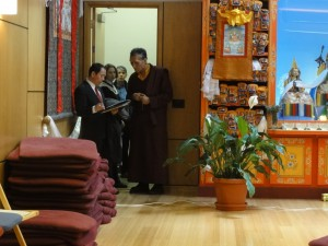 Lobsang Nyandak, representative of H.H. the Dalai Lama to the Americas, and Yangsi Rinpoche, Maitripa College president, check the Maitripa College meditation hall seating capacity and staging plans, for a private event.