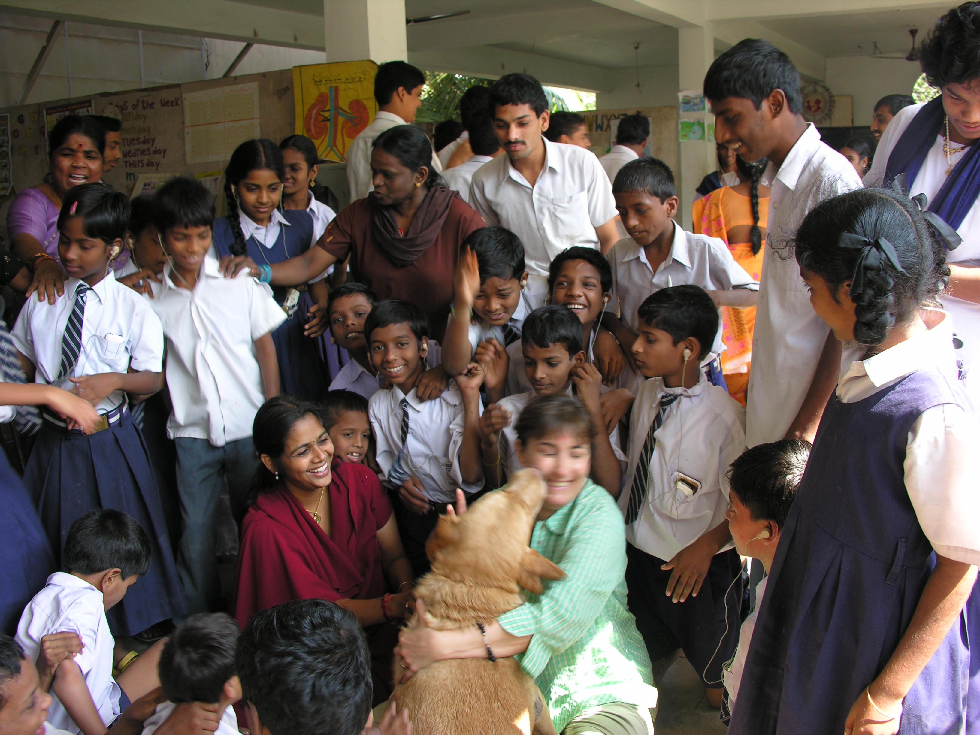 "Eileen Weintraub with ""Vicky"", the Dr. Paws therapy dog, at the Simhans School for the Deaf in Visakhapatnam, India."