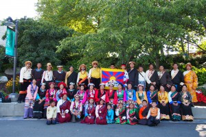 Tibetan community members in their national costumes, just before Seattle's summer Seafair Torchlight Parade.