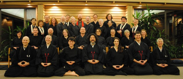 Members of the Victoria Zen Centre, gathered at their zendo: Front row (left to right): Doshu Rogers, Eko Goldberg, Geoff Kido deRosenroll, Nori Kozan Nishigaya, Sonja Kerr, Charles Yushin Rose, Soshin McMurchy. Second row: Danielle Pope, Tyler Strazza, Jeff Genkyo Bosma, Syndey Schaffer, Cory Chodo Ronningen, Gisela Shinzen Ruebsaat, Jason Dunphy, Pat Robinson and Pola Wojnarowicz. Third row: Frances Sekito Bryan, Monika Myoko Winn, Kathleen Laird, Bill Trott, Elizabeth Grove-White, Ken Ralfs, Catherine Sheehan, Leslie Sochowski, Sean Kyoku Holland and Phil Goju Hoover. Back row: Shawn Stebbins, Tom Doyu Oak, Eshu Martin, Michael Hargraves and Blair Lekness.