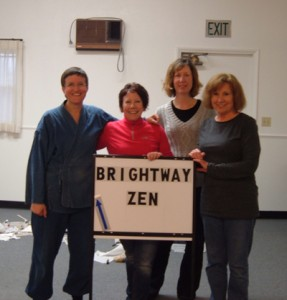 Sangha members Domyo Burk, Amy Plavak, Dawn Holt and Ellen Carlin, creating a sign to help people find the zendo