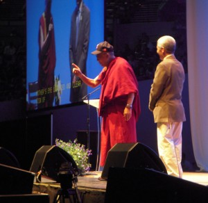 The Dalai Lama stands on the stage, during his presentation in Portland May 11