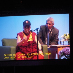 The Dalai Lama's every expression was visible on the twin big screens in Portland