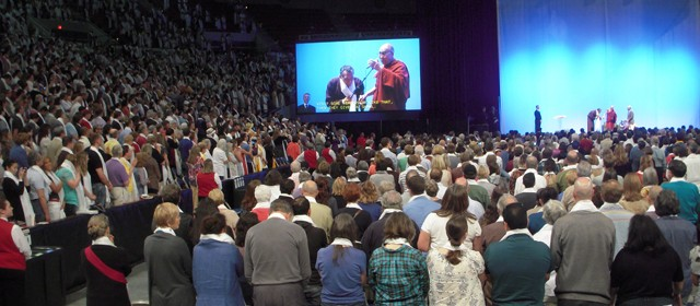 The entire crowd symbolically offered katas, Tibetan ceremonial offering scarves, to the Dalai Lama