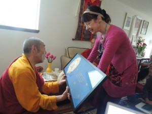 Airdrie Thomsen offers Rinpoche a painting of Yeshe Tsogyal, with the mantra of Guru Rinpoche