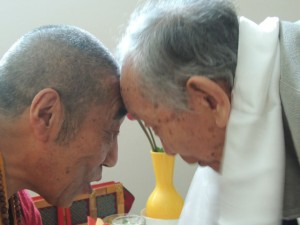 Lama Sonam and Geshe Nornang exchange blessings after the teachings