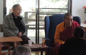 Lama Sonam listens to Dachen Kyaping who attended the teachings, while Geshe Nornang looks on