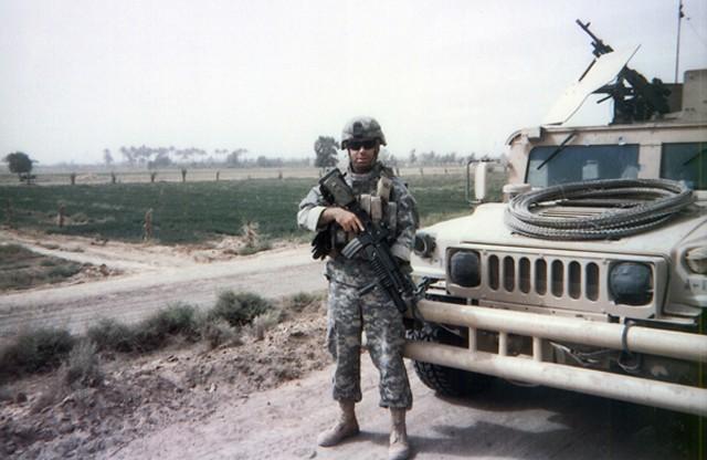 Paul Kendel with his Humvee in Iraq