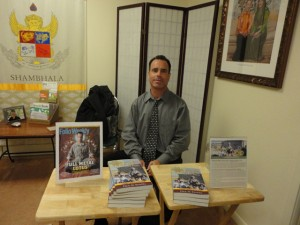 Paul Kendel selling his book at the Portland Shambhala Center, after his talk