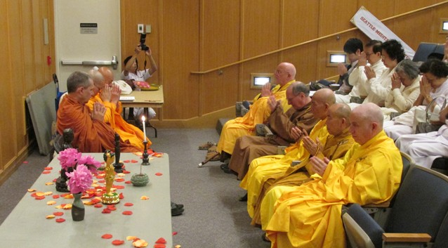 Monks chanted the praises of the Buddha, at the beginning of the ceremony.