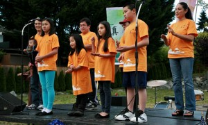 """Members of the children meditation class performed sign language and sang """"The Four Tenets of Chung Tai."""