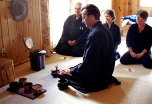 Chris Ezzel, board president, leads a tea ceremony