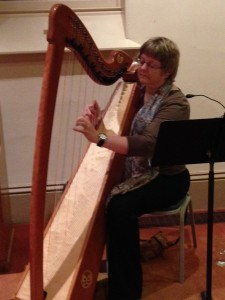Kim Swennes, a harpist, creates music that brings peace to people at the ends of their lives