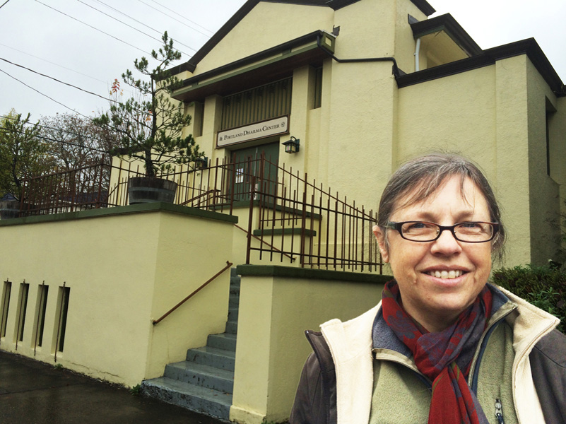 Sakula Mary Reinard, spiritual director of Portland Friends of the Dhamma, stands in front of the Portland Dharma Center, also known as the Dharma Rain Zendo, which Portland Friends of the Dharma intends to buy