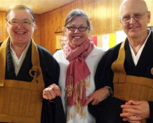 Dharma Rain Co-Abbots Gyokuko Carlson, left, and Kyogen Carlson, right, pose with  Sakula, center, during a recent gathering at the zendo