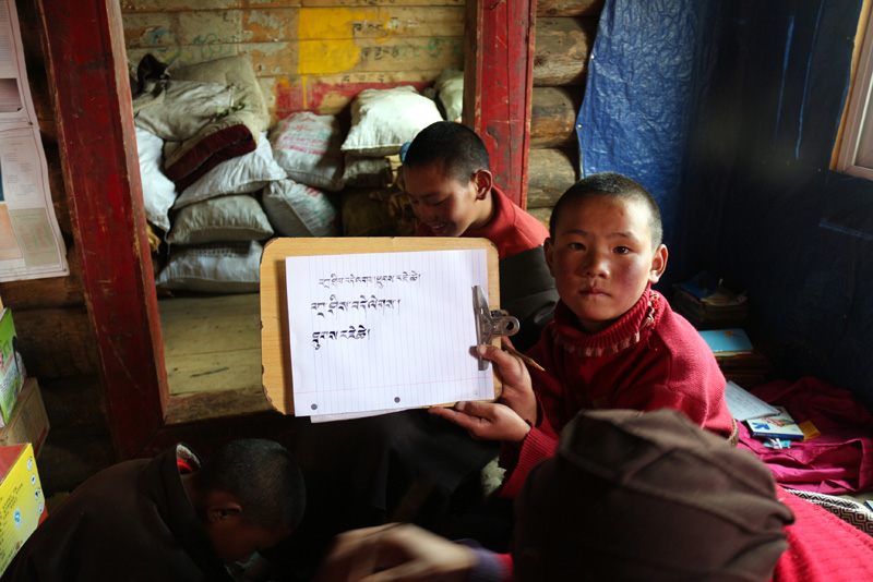 Girls at the school learn to write Tibetan script