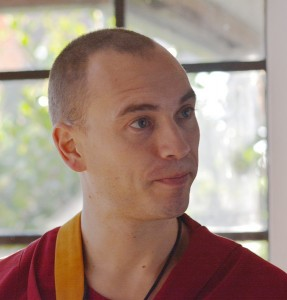Ven Thubten Jampel in conversation with other monastics