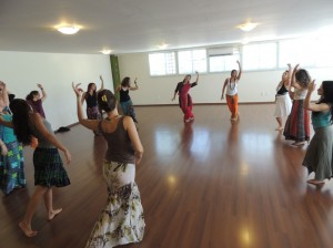 "Dancers dynamically stretch opposite energies of reaching towards transcendence, while touching earthward to remain grounded, at the ""OM TARE!"" studio in Brasilia"