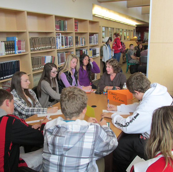 Eileen McCann talks about the dhrama to a group of students at the Snohomish High School Library.