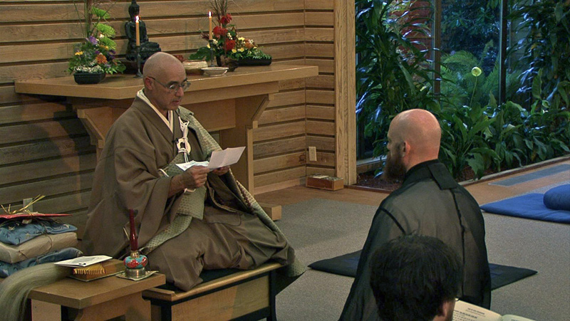 Genjo Marinello Osho faces Eshu Martin during the Osho ceremony