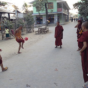 Monks playing soccer, Mandalay, Myanmar