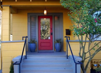 The front entrance of bright yellow Seattle Mindfulness Center is welcoming