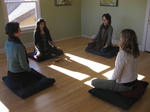 The therapist team meditates together. From left to right: Mary Roy, MSW; Neha Chawla, Ph.D.; Lucianne Hackbert, Ph.D.; Teresa Williams, MSW