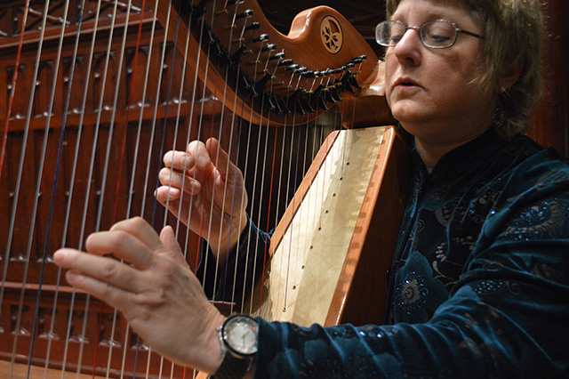 Kim Swennes, musical thanatologist, playing the harp