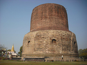 The great stupa in Sarnath, where Buddha first taught the dharma, is a major Buddhist pilgrimage site in India