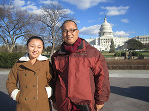 Yangchu Tso, daughter of Dr Tsering Kyi, and Dr. Kunchok Gyaltsen, in front of the capitol building in Washington, D.C. Tso was studying English in Virginia