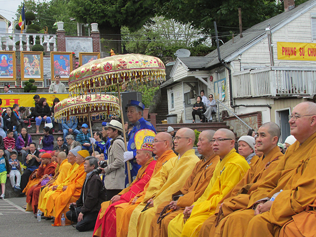 Monks line up for the consecration of the new statue of Buddha as a boy, for the Vesak celebration on May 10