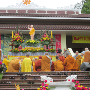 Monks bowing before the statue, which is at the front of the main shrine room at Colam Temple