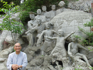 Thay Kim, a leading monastic at Co Lam, sitting at the circle of life sculpture