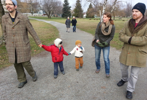 Justin, Tivon, Theo, Allison, and Jason walk to the park, while Lee Anne and Genny look on, during the first meeting of the BCIMS family group