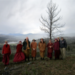 Monks, nuns, and dharma friends on a windy hill near the Old Gold Mine Hermitage