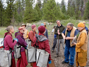 Old Gold Mine Hermitage owner-manager Roger Fox, on right, gives the nuns tree-planting instructions