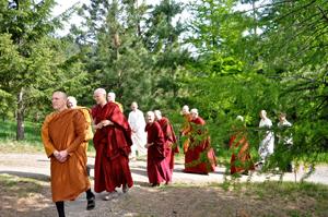 Ajahn Passano leads the walk to the Chenrezig Meditation Hall at Sravasti Abbey