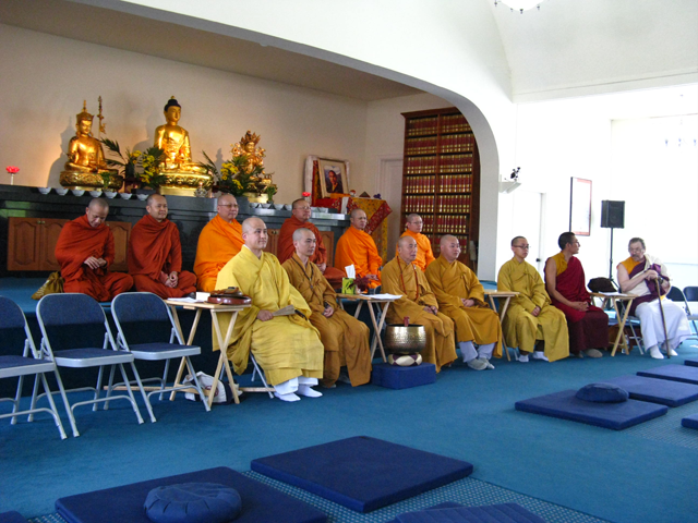 Monks seated in the main shrine room at Nalanda West, before the ceremony started
