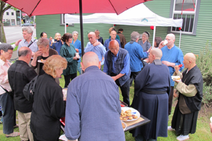 A picnic reception followed the event. People attending included Alan Gensho Florence in foreground, Lisa Jiki Shin Bland, Roy Tribelhorn, Kay Haynes, Steve Paget, Brenda Wajun Loew and Michael Podlin