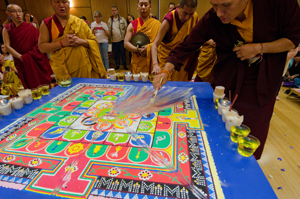 The sand mandala is ritually swept away, representing impermanence