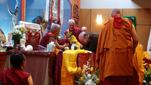 Professor Jim Blumenthal offers the body, speech and mind mandala offering to Lama Zopa Rinpoche, in thanks for the teachings