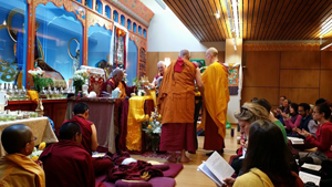 Students making the mandala offering mudra (hand gesture), during the offering ceremony